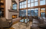 Great room with Fireplace, ski run views, and ample seating.